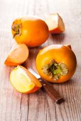 fresh sliced persimmons and knife