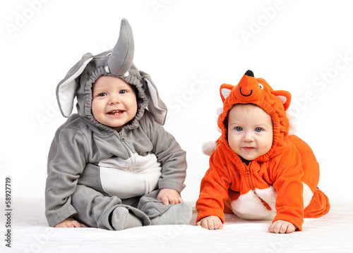 Two baby boys dressed in animal costumes over white - 58927719