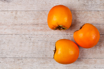 three fresh persimmons