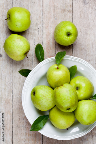 fresh green apples in plate