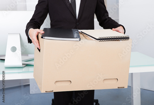 Businessman Holding Box