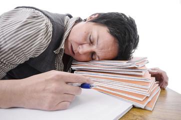 teacher / student sleeping on a pile of books