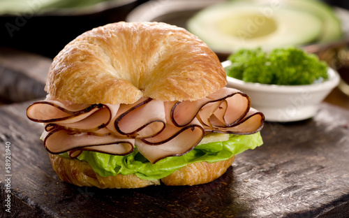 Closeup of a ham and cheese croissant sandwich.