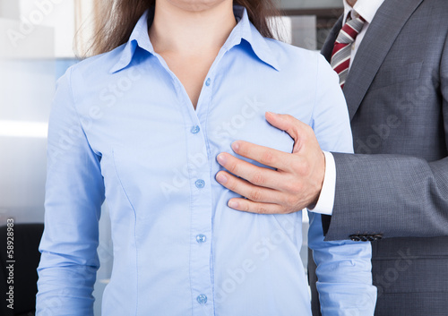 Businessman Touching Businesswoman