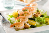 Closeup of a salad with shrimp and vegetables.