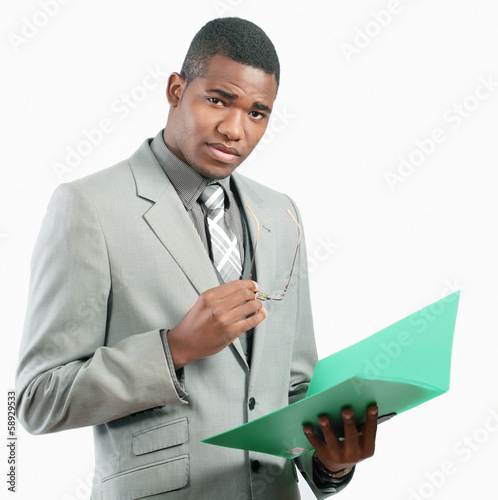 Serious businessman holding file