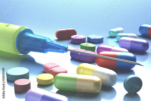 Syringe And Pills. Clipping path included.