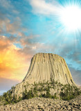 Devil's Tower rising into the sky at sunset, Wyoming