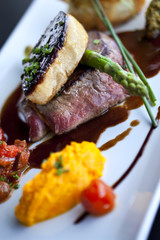 Piece of beef, foie gras, asparagus and carrots puree