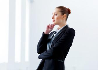 Attractive businesswoman in black suit