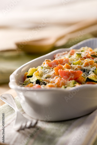 vegetable gratin with zucchini, carrots, tomatoes and cheese.