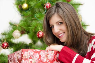 Beautiful girl holding  Christmas  gift