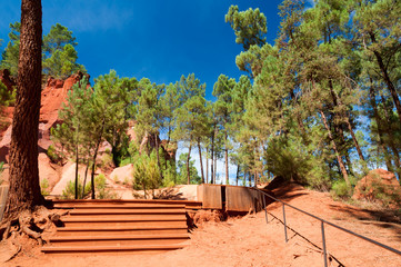 Stairs on wlking path on Le Sentier des Ocres in Roussillon in F