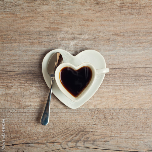 Heart shape coffee cup on wooden table