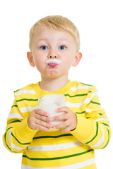 Funny kid drinking milk from glass