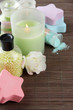 Composition with Aromatic salts in glass bottles and candle,