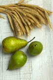 Pears and sheaf on wooden background