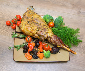 roasted leg of lamb with vegetables, greens and prunes