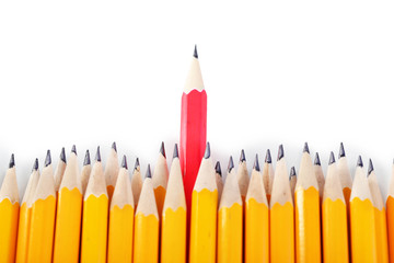 Celebratory pencil among usual pencils, isolated on white