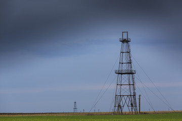 Old oil and gas rig profiled on sky