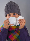 Cute boy drinking tea and wipes a nose with napkin