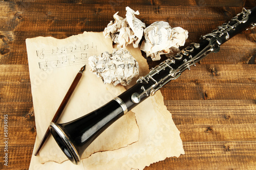 Crumpled paper balls with music sheets and clarinet