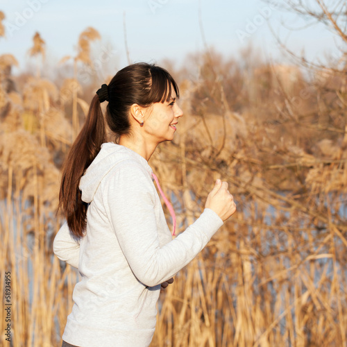 Happy middle-aged woman running
