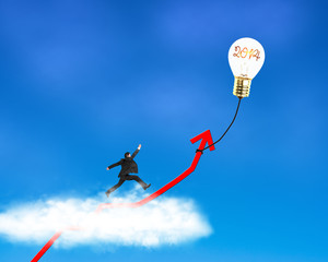 Businessman running on growth red arrow with lamp balloon