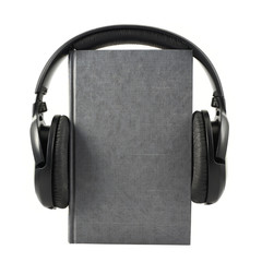 Book with a headphones on it, isolated