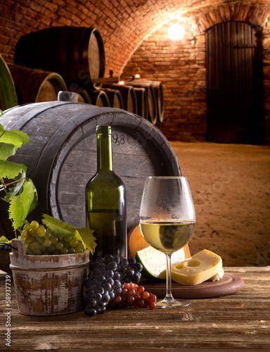 Wine bottle and glasses on wooden table