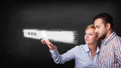 Young business couple touching web browser address bar with www
