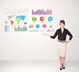 Business woman with colorful graphs and charts