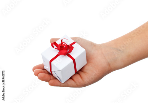 Small christmas gift in child hand