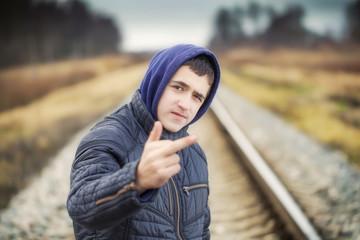 Boy showing middle finger