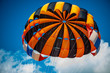 parachute and airplane on blue sky
