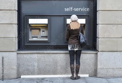 Girl at ATM - 58941960