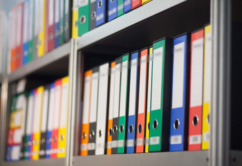 colorful folders on bookshelf