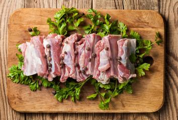 Raw pork ribs on a cutting board