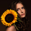 Beautiful girl with sunflower