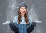 Fototapety Cute girl in winter clothing with snowflakes
