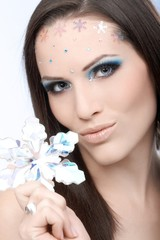 Glamorous makeup on young beauty