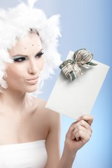 Beautiful woman holding present