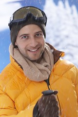 Close-up portrait of happy skier