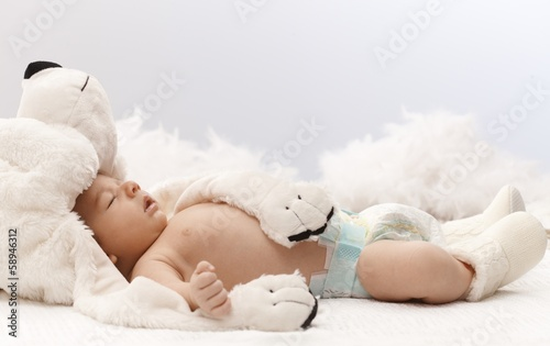 Sleeping baby with bear
