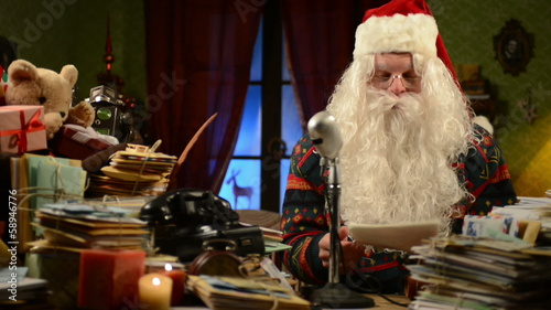 Santa Claus reading the news of North Pole