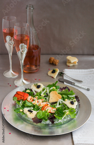 Caesar salad with lobster and sparkling wine