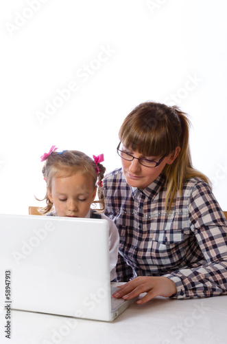 mother and daughter on the computer.
