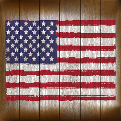 Grunged Unighted States of America Flag over a wooden plank  bac