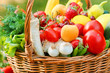 Organic fruits and vegetables in a wicker basket
