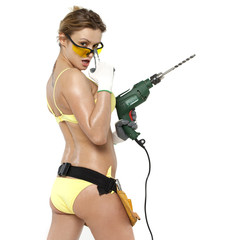 Sexy woman holding a construction drill